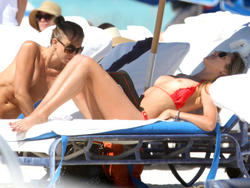 http://img181.imagevenue.com/loc121/th_260146114_lauren_stoner_bikini_topless_march19_2012_22_123_121lo.jpg