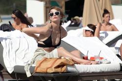 http://img181.imagevenue.com/loc238/th_311906425_Mischa_Barton_Bikini_Candids_on_the_Beach_in_Miami_December_27_2011_133_122_238lo.jpg